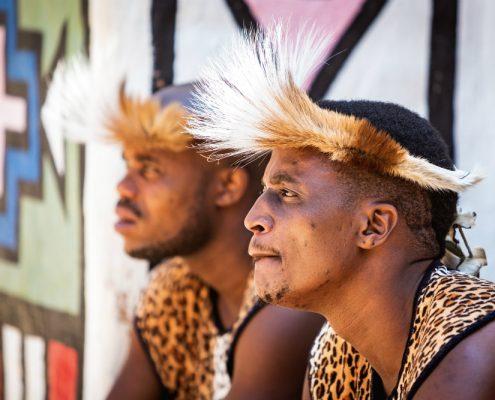 Zulu tribe members wearing traditional warrior